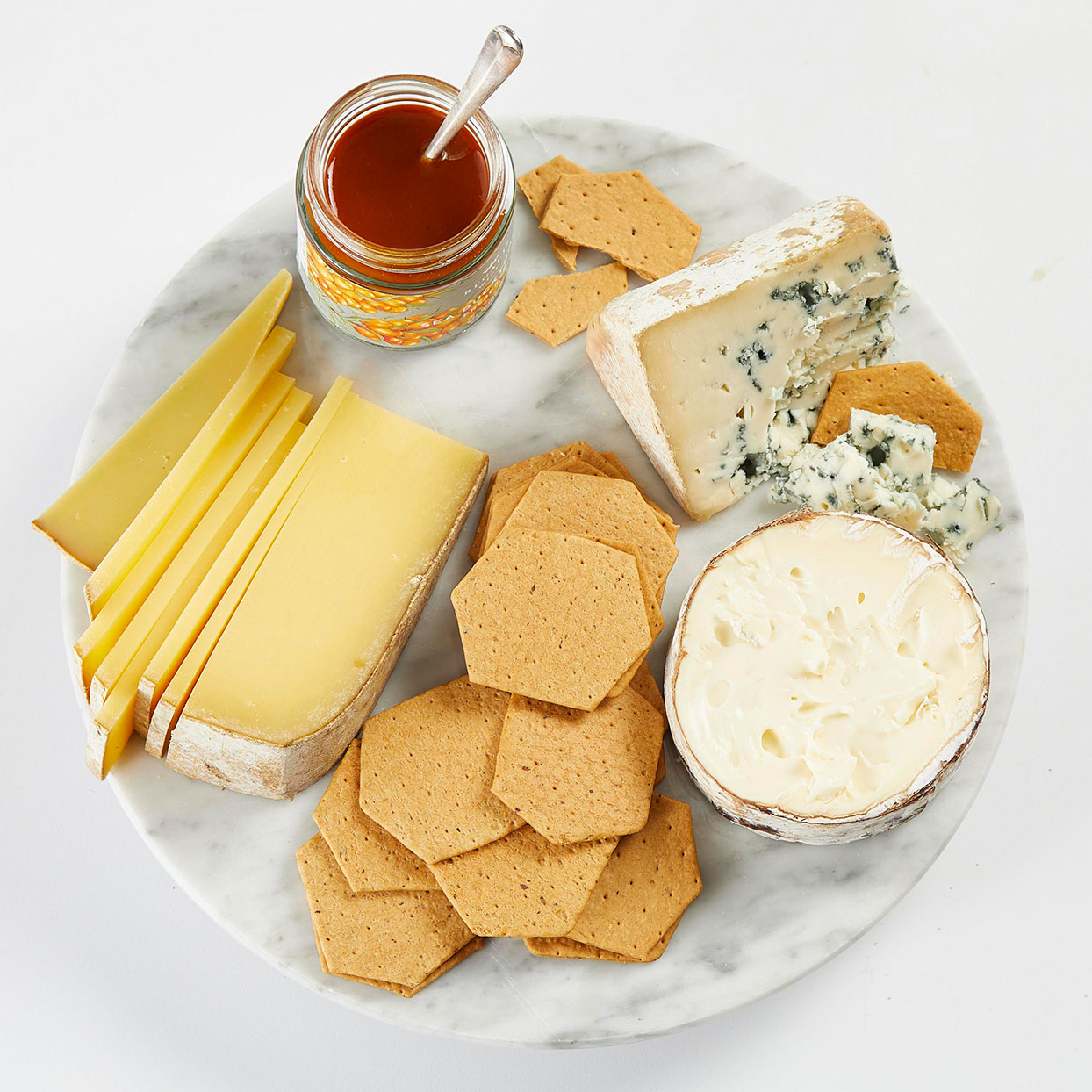 cheese plate with crackers and sauce