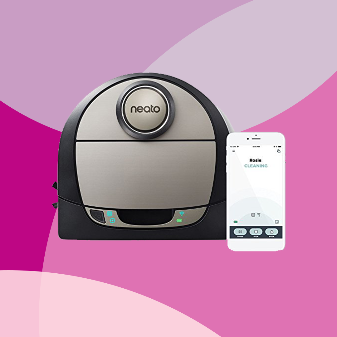 neato brand robot vacuum cleaner next to a smart phone with floor plan of a house on the screen