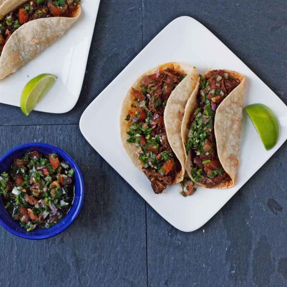 Use your crock pot for perfectly tender beef in this easy taco recipe. The quick fresh pico de gallo adds crunch, flavor and color, but your favorite fresh salsa will make a great taco topper in a pinch.