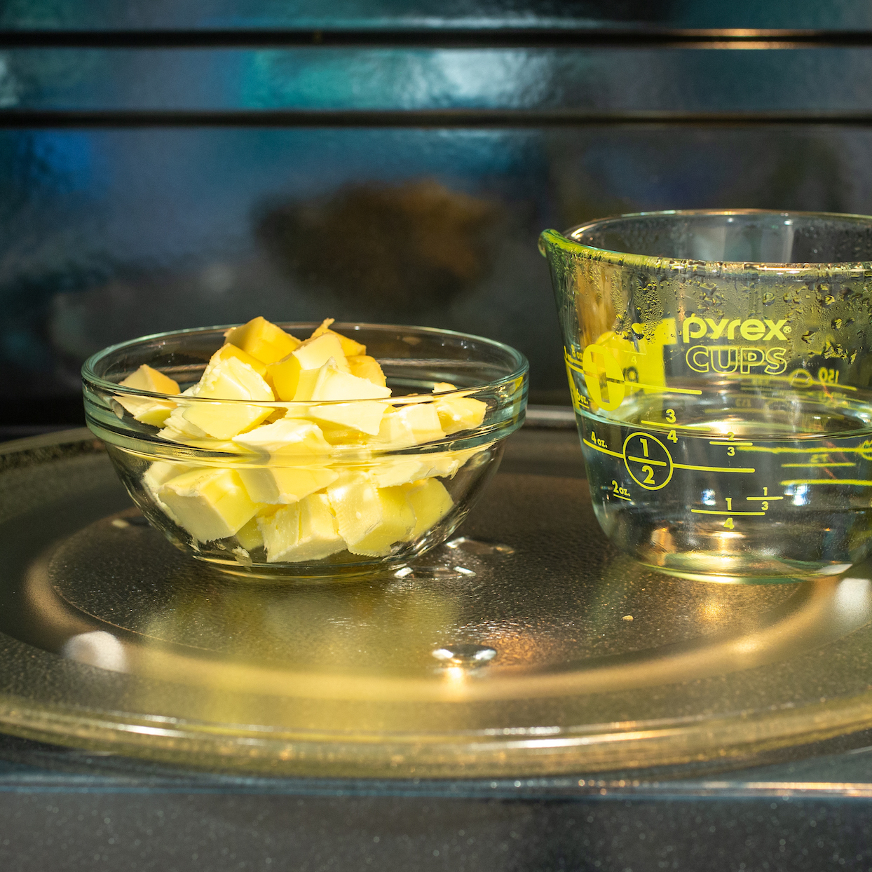 soften bowl of cut up butter with a measuring cup of water in the microwave
