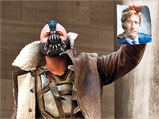 The Dark Knight Rises Star Tom Hardy Talks About Playing Bane And Inventing The Villain S Controversial Voice It S A Risk Ew Com