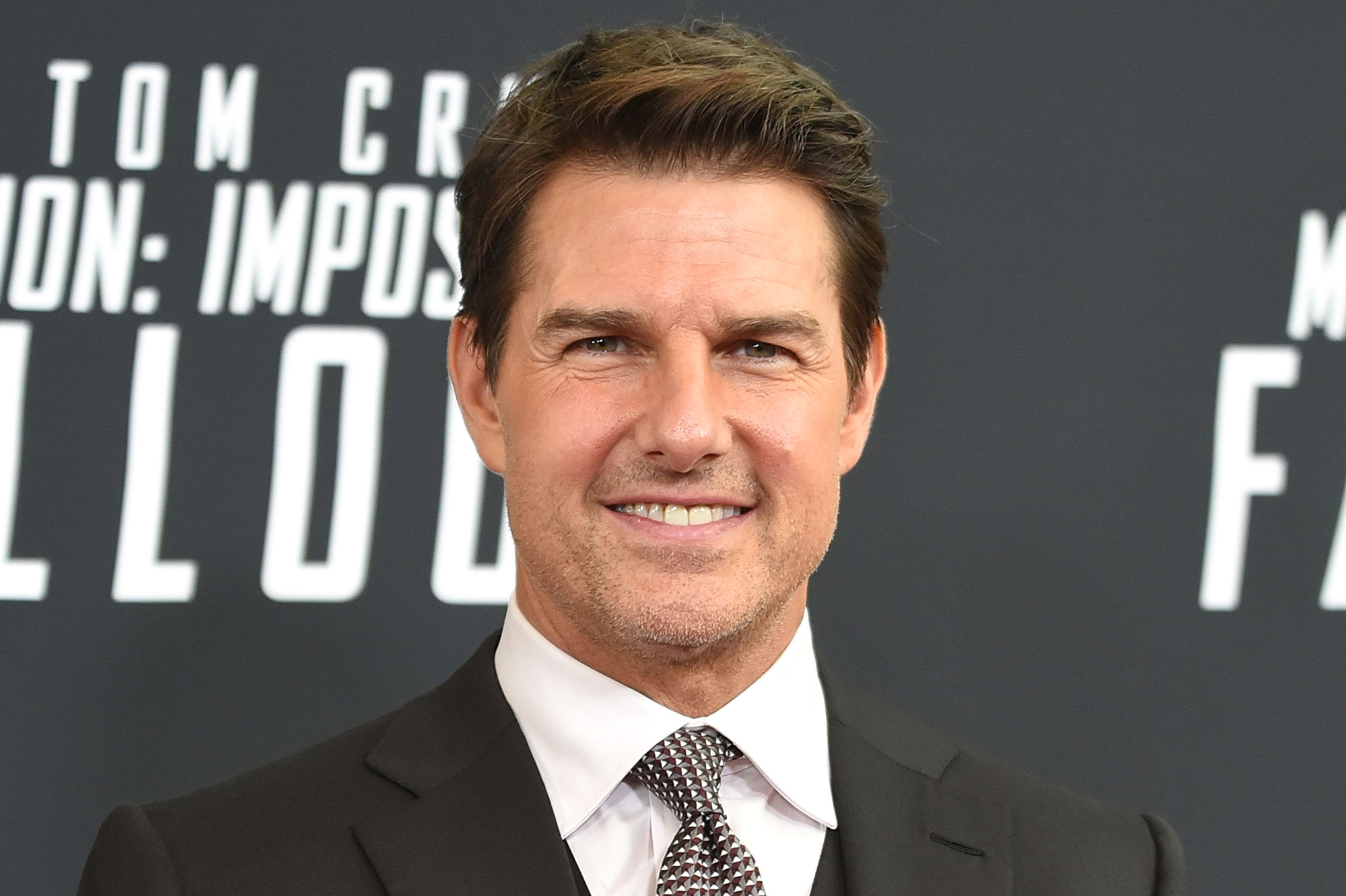 Tom Cruise Puts On Mask To See Tenet In Theater Ew Com